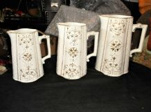3 X ANTIQUE GRADUATED JUGS TEXTURED BODY WITH GILDED HIGHLIGHTED DESIGN